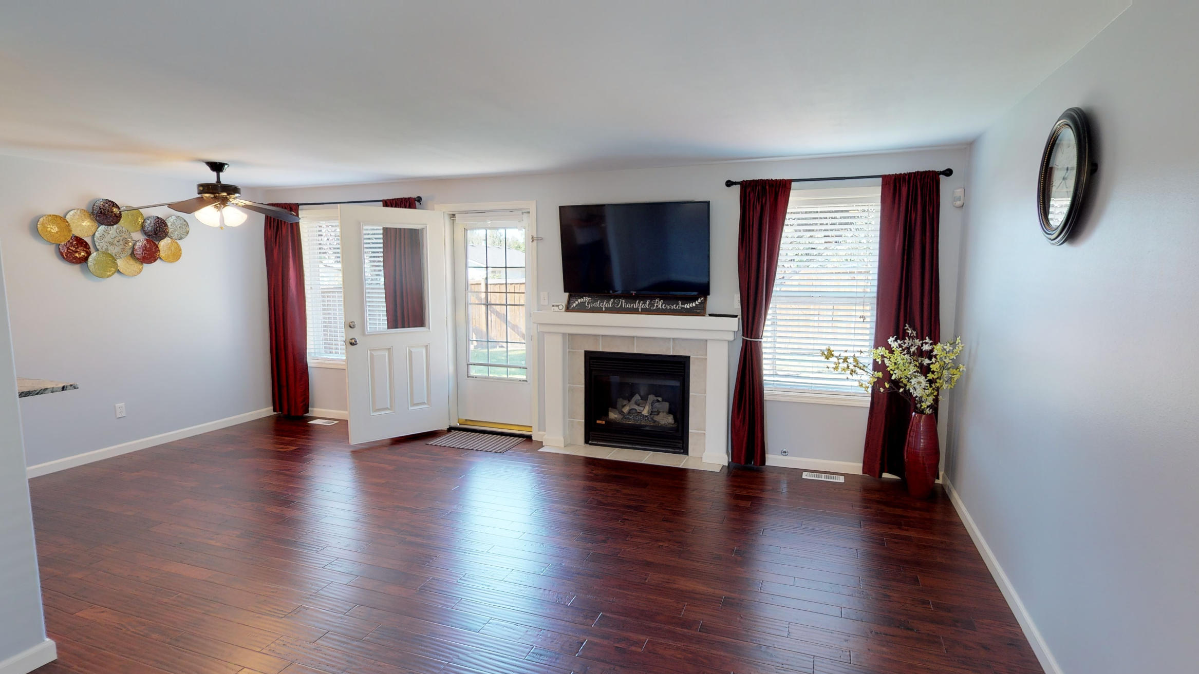 open space, great room layout, hardwood floors, gas fireplace, tile surround